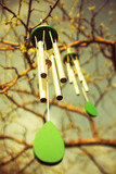 A close-up of a chinese traditional wind chime music with a flor poster