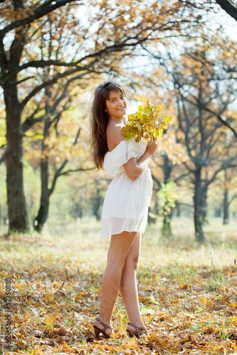 girl in white dress at autumn park