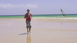 Woman jogging on beautiful beach, super slow motion, 240fps