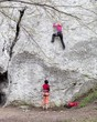 Young women climbing on limestone wall