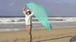 Sexy woman with pareo on beach, super slow motion, 240fps