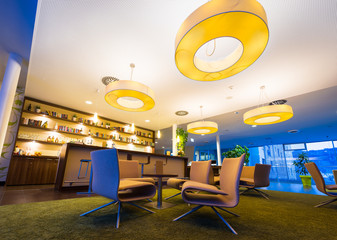 wide angel of modern lounge in hotel bar with huge lamps
