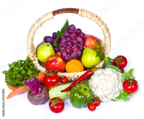 Composition of fruits and vegetables in wicker basket