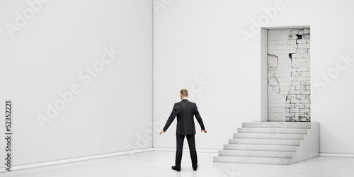 Poster businessman into the room with blocked doorway
