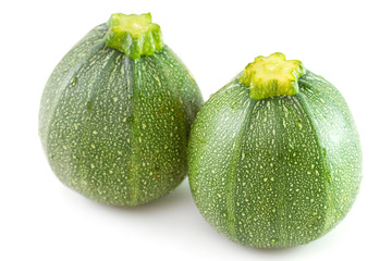 two zucchini on white background