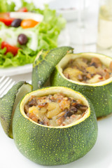 baked zucchini on dish with salad