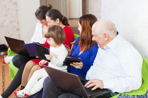 happy  family using few laptops