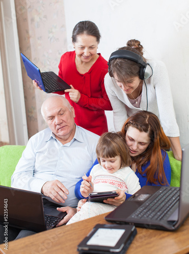 Happy  family uses few  electronic devices