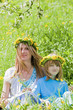 mother and son with flower wreaths
