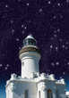 Lighthouse upward view against starry sky