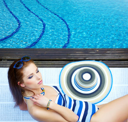 beautiful long hair female model posing by the pool,
