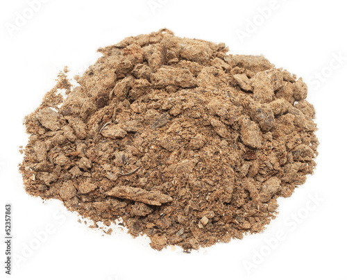 pile of sunflower meal  background. Food for horses and farm ani