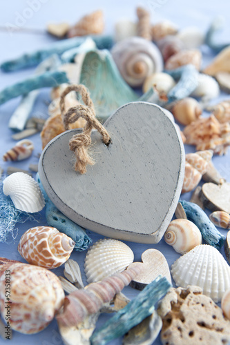 Wooden background with sea shells an hearts