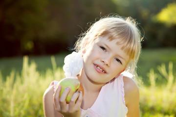 Blonde girl eating apple