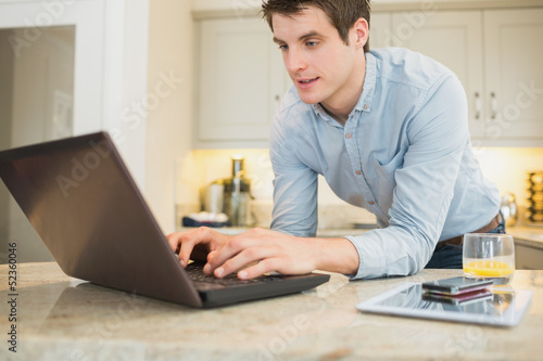 Enthusiastic man surfing the internet