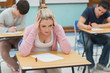 Thoughtful student sitting in classroom