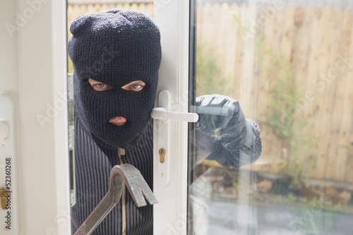 Burglar looking if someone is into the room