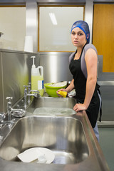 Unhappy woman washing the dishes