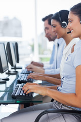 Cheerful team of call centre employees