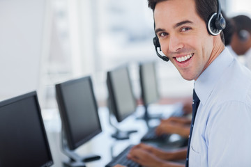 Focus on a joyful call centre agent
