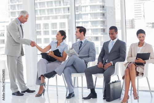 Director welcoming a businesswoman