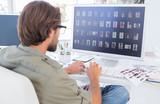 Photo editor looking at thumbnails on computer