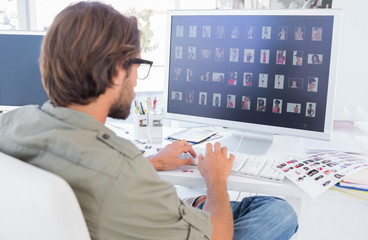 Photo editor looking at thumbnails on computer