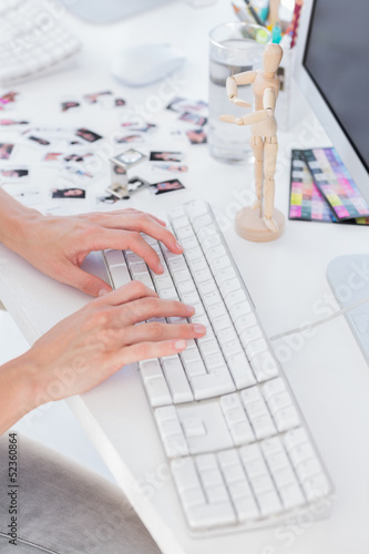 Close up of womans hands typing