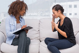 Sad woman speaking to her therapist
