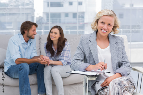 Young couple and therapist looking at the camera
