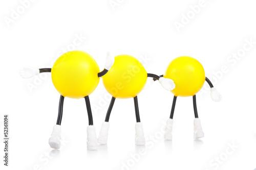 Three  toy little men on a white background