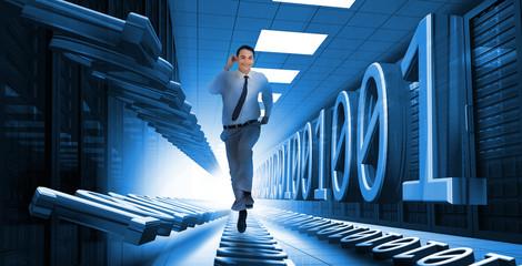 Businessman sprinting through data center