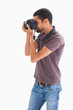 Stylish man taking photograph with digital camera
