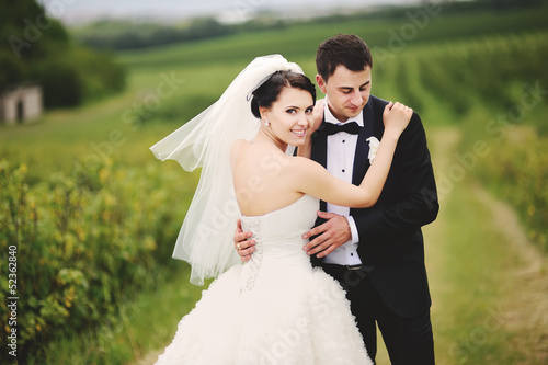 outdoor portrait of  wedding couple