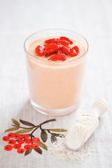 Smoothie with goji berries and oat bran powder, selective focus