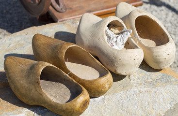 pairs of old wooden clogs