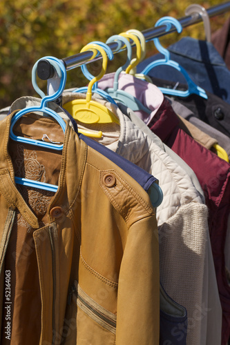 clothes and leather jacket displayed at garage sale