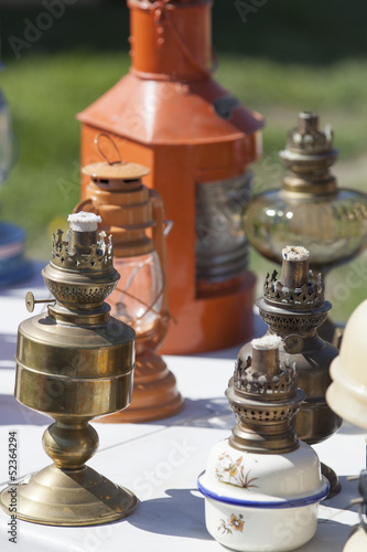old copper and brass oil lamps at flea market