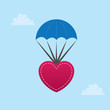 Heart parachuting down from the sky