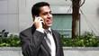 Handsome hispanic businessman talking at phone