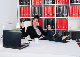 woman in office hours blowing soap bubbles