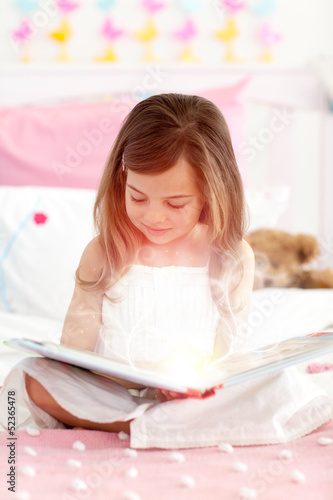 Little girl reading a storybook