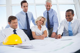 Business people discussing construction plan