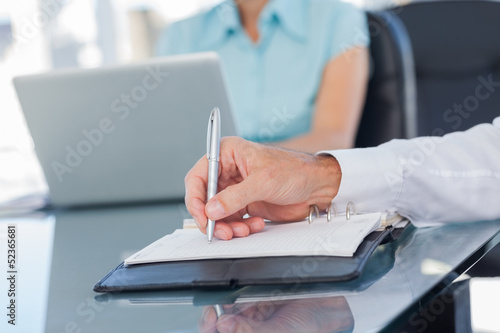Close up of businessman writing