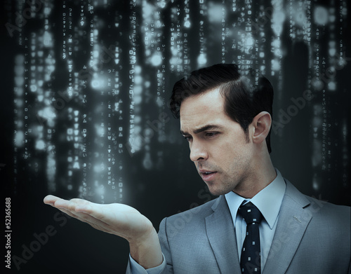 Businessman holding hand out over matrix