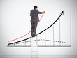 Businessman standing on ladder drawing large graph