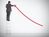 Businessman standing on ladder drawing red curve arrow
