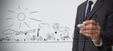 Businessman drawing a town