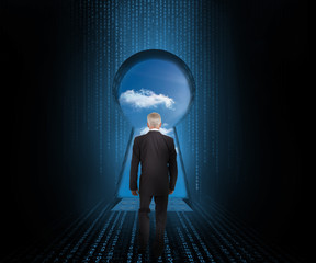 Doorway revealing cloudy sky with businessman looking