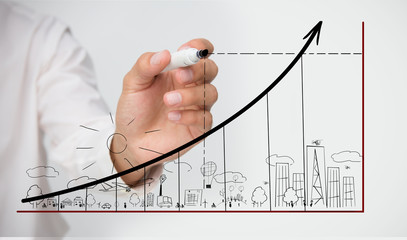 Businessman drawing graph over town doodle